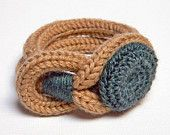 Spool knitted bracelet with crochet button (This also looks like an i-cord woven around to make the bracelet)