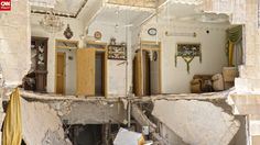 "This picture shows the remains of a Free Syrian Army commander's home. ""The living room was literally sliced in half,"" he said."