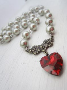 Red Heart Necklace, Pearl Necklace, Ruby Red Crystal, Heart Jewelry, Almond Pearls. $27.00, via Etsy.