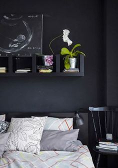 Try hanging an IKEA shelf lengthwise above a bed for bedside storage in a tiny bedroom.