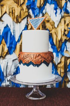 metallic + fringe cake // photo by Mr. Haack // cake by Sweet & Saucy Shop // View more: http://ruffledblog.com/metallic-orange-county-wedding/