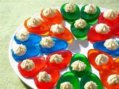 Folllow recipe for Jello Jigglers, pour into a deviled egg dish, then serve with whip cream when set.