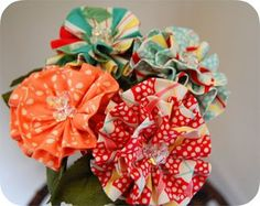 Another fabric flower tutorial AND this blog site is full of craft ideas!!!!