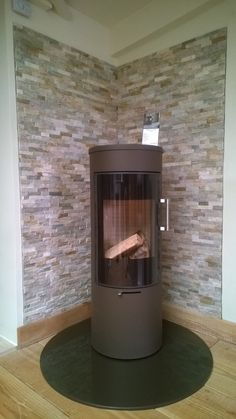 Showroom Display - Rais Viva 120 ( Mocha ) has had a little face lift with oyster split face tiles. House, Remodel, Modern, New Homes, Log Burner Living Room, Home Decor, Stove, Modern Fireplace, Light My Fire