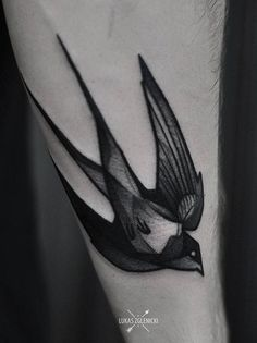 Lukas Zglenicki bird swallow tattoo