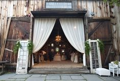 Such a gorgeous backdrop for an intimate wedding.  What a great idea to incorporate vintage doors into the design. And flanking them next to the old, giant barn wood doors is perfection.  doors and weddings.  weddings.  rustic wedding.  wedding decor.  vintage wedding.  wedding ideas.  wedding design.  vintage doors.