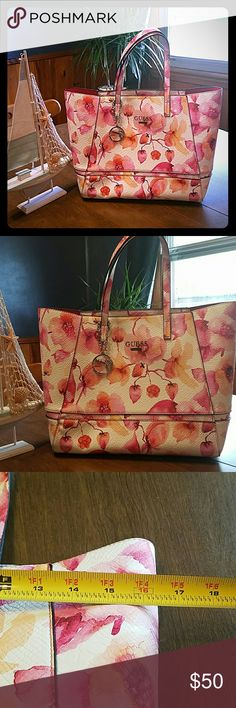 Floral large guess purse SALE!!!!Last price drop!!!I love this bag, the pattern is so bright and summary. Large in size at 16inch by 12inches with handle, this bag is sure to get complements. With adorable guess keychain attached. Bag is in like new condition as I have barely even used it since I own another floral bag in pink as well. Very roomy inside/NO pockets so perfect for a clutch and bigger items ;)!! Also could make a great Vaca bag or Stylish mommy bag!! Bags
