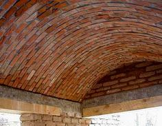 Using faux brick plywood to create internal arch down the wall and graffiti?