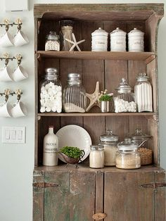 Beach House Decorating with Natural Elements!!! Bebe'!!! Great display bookcase with a coastal style!!!
