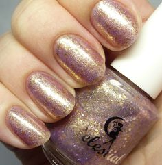 Celestial Cosmetics - Vegas Sparks. Swatched on 3 nails. Fill line is a little low. $8 shipped
