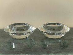 """Crystal Votive Candle Holders (2) Price $5.00 Address Whitby, ON L1R 2S4, Canada  These beautiful candle holders are made of 24% lead crystal. Each candle holder is 3-1/2"""" in diameter and 1-1/2"""" high. Each holder comes with an unscented votive candle.  These candle holders are brand new (original stickers are still attached) and they are both in perfect condition. The candle light sparkles off ..."""