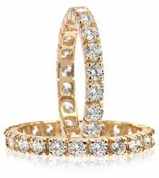 Ziamond cubic zirconia eternity bands in solid 14k yellow gold.