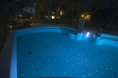 Mosaic tiles with stars in the bottom of the pool
