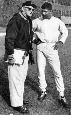 Chicago Bears coach George Halas talks with running back Gale Sayers during workouts at Wrigley Field on Oct. 26, 1967.