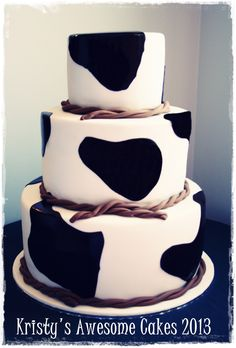 3 tiered cow spots cake brown spots. fondant rope. country wedding. Kristy's Awesome Cakes