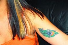 Peacock feather tattoo designs wrist