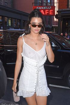 Kendall Jenner revealed perhaps a little too much as she went braless in a semi-sheer top while strolling through New York on Saturday