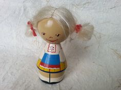 Here is for your attention, a small cute vintage doll, made of wood in Latvia during Soviet times in 1970s. This lovely doll with nicely fit your interior. Excellent good vintage condition, please see the photos. Nice item for your collection.  Size: height 9 cm.  Please do not hesitate to contact me and ask any questions.  In order to see toys or other vintage stuff, please visit my store at: http://www.etsy.com/shop/Astra9?ref=si_shop  Shortly about the terms:  Paym...