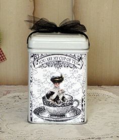 """Tea Tin with Flip Top and lovely Victorian tea graphics. Will hold 12 teas or 4 oz. of loose tea. 3.5"""" tall by 2-7/8"""" wide. Food Safe and perfect for tea or candy. Comes filled with 6 matching tea env"""