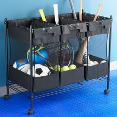 We love these sports equipment organizers from The Container Store.  Line it up on the wall of the garage and move it if you need to - it's on wheels!