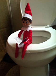 Day 3: Mr. Elf was caught taking care of business and reading his newspaper.