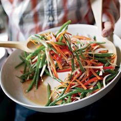 Green Bean Slaw | In this salad, tender haricots verts get tossed with crunchy strips of carrot, red pepper and parsnip. When TV personality Rachael Ray (who is originally from upstate New York) visited the Beekman farm, Lee Woolver made a version of this salad with bacon, but it's just as delicious without.