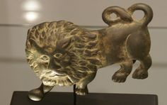 belt buckle in the form of a lion, Roman, bronze, circa 3rd-4th Century A.D. 4 3/4 inches long