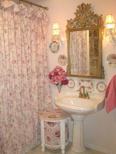Hmm..wonder if decorating a bathroom like this might be a way to get that lean toward 'shabby chic' out of my system...