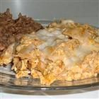 Chilaquiles II  Easy, authentic Mexican recipe that is a casserole of tortilla chips mixed with eggs and salsa, and topped with cheese. Serve with refried beans