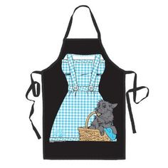 This fun character apron features a print of Dorothy's blue and white gingham patterned dress with her trusty companion Toto sitting in a wicker basket.