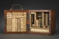 If She Thought It Would Help, Zelda Would Use Her Antediluvian Curse Cache to Attain Her Revenge by Jody Alexander // wooden box packed with books and found objects, book are bound in various exposed spine structures ranging from split thongs, Coptic, longstitch, ticketed, French stitch and sewing over cords