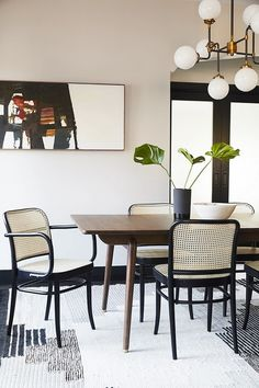 Bright dinning space with retro inspired chairs, and a retro chandelier