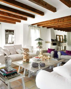 Wood beams and jewel tones: a rustic house