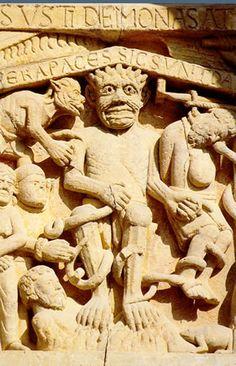 Los suplicios de Satán Detalle del tímpano de la portada oeste de santa Fe de Conques.