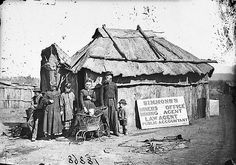 Simmons' (miners' office, mining agent, law agent and public accountant) and family outside his bark hut, Gulgong area, / American & Australasian Photographic Company Australian Bush, Australian Homes, Australian Animals, Family Tree Research, Bird People, Women In History, Vintage Images, Vintage Pictures, Tasmania
