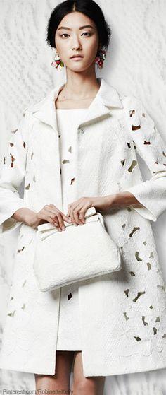 Dolce  Gabanna....why do I LOVE expensive stuff....Beautiful white eyelit coat. Just gorge!