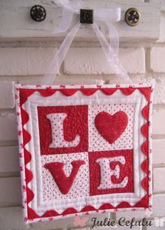 """This sweet """"Love letters"""" wall hanging is the perfect Valentine's Day decoration for your home, or as a gift."""