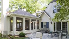 Screened porch addition with beadboard exterior (lower portion).