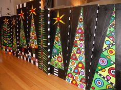 Oh Christmas trees~ Wow, would this be fun! Maybe use glue and oil pastels on black construction paper!