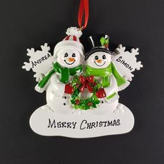 Off Shipping on or More Items Worldwide ------------------------------------------------------- Beautiful Hand Crafted Snowman Couple themed Christmas Ornament. Also available in Family of 4 and I will hand-personalize your Family Ornament, Christmas Tree Ornaments, Personalized Ornaments, Handmade Ornaments, Holiday Gifts, Christmas Gifts, Christmas Messages, Christmas Couple, Etsy App