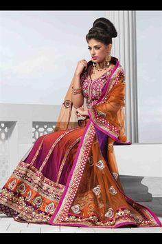Rust & rani pink net lehenga choli giving stylish look