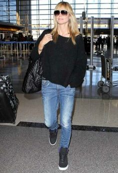 Heidi Klum wearing Supra Skytop Sneakers in Black and Purple, G-Star Arc 3d Kate Tapered Jeans. Heidi Klum LAX Airport March 10 2014