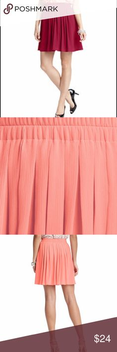 """Never worn Pleated crinkle chiffon skirt Love the flirty swing of this dainty little number—the blissfully comfy elastic waistband is definitely the best part. Lined. 19"""" long. polyester, machine washable, never worn. Pomegranate red color as in the first image but other images show pink. Not available on Ann Taylor anymore. Ann Taylor Skirts Mini"""