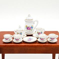 """Odoria 1:12 Miniature 15PCS Tea Cup Set Pink Rose and Golden Trim Porcelain Tableware Kit Dollhouse Kitchen Accessories $5.03 1:12 Scale Kitchen Miniature Included: 1x Teapot, 1x Creamer, 1x Sugar, 4x Cups, 4x Saucers, 4x Cake Dishes) Approx.Size: 0.49""""-1.0"""" /// 1.25cm-2.5cm(L); 0.12""""-1.25"""" /// 0.3cm-3.2cm(H) High Details & Qualities. For Scenes Building of Kitchen, Diningroom, Livingromm, Restaurant, Bar, etc. Fit for Most of 1:12 Scale. Also Fit Action Figures / Dolls Are about 6 Inches or…"""