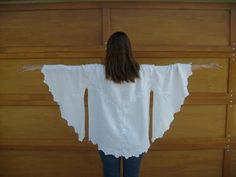Tablecloth tunic. We all had a dress made from lace tablecloths when I was in high school. apparently it has made a short reappearance. It is a fun idea and limited only but your imagination...tutorial here