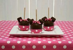 Minnie Mouse/Mickey Mouse Carmel Apples.  Step 1: boil water and quickly dip apples to remove wax film put on apples (will help caramel stick) Step 2: Dip apples in caramel to coat them then place in fridge to harden the caramel. Step 3: Using toothpicks stick two marshmallows where Minnie/mickey's ears would be. Step 4: Melt dark/milk chocolate candy melts and thoroughly cover the apples in the chocolate. Let chocolate harden. Step 5: Melt white chocolate candy melts to dip the bottom half…