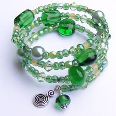 Bracelet made with lampwork beads made out of recycled Perrier water bottles