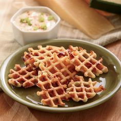 For a cheesy, savory appetizer, try this recipe for bacon cornbread waffles in bite-size form, paired with a maple dijon dip.