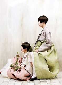 The models are wearing Korean traditional dresses-korean vogue by the style files, via Flickr