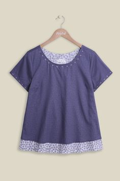 Double the trouble or no trouble at all? Our new voile Double Trouble Dotty Top is the perfect lightweight piece for your summer wardrobe, inspired by the North Meadow National Nature Reserve. The top features delicate stitching around the scoop neckline hem and the sleeves, finishing with a double layered hem with a purple dotted print.